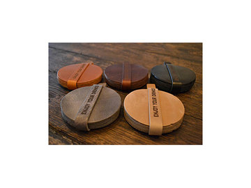 Coasters of genuine leather