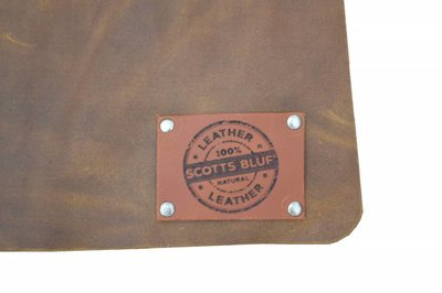 Barbecue apron made of supple cognac cowhide